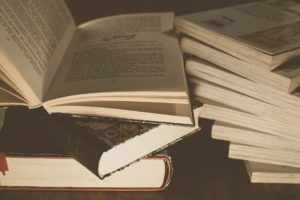 Sepia-toned picture of two piles of books